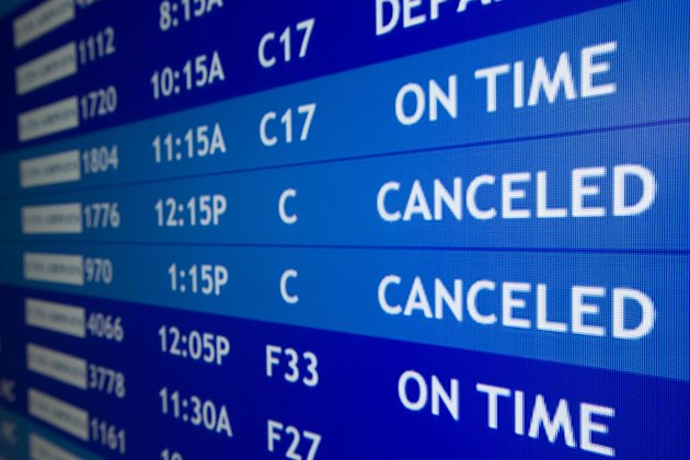 Two flights to Boston are listed as canceled at Philadelphia International Airport, Friday, Feb. 8, 2013, in Philadelphia.   Airlines have already canceled more than 2,700 Friday flights as they get r