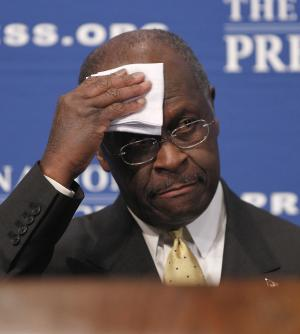 """Republican presidential candidate, Herman Cain wipes his forehead before answering questions at the National Press Club in Washington, Monday, Oct., 31, 2011. Denying he sexually harassed anyone, Cain said Monday he was falsely accused in the 1990s while he was head of the National Restaurant Association, and he branded revelation of the allegations a """"witch hunt."""". (AP Photo/Pablo Martinez Monsivais)"""