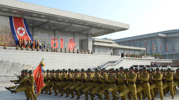 Military personnel march during an event marking the 61st anniversary of the armistice that ended the Korean War