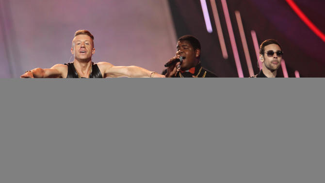 """FILE - This April 14, 2013 file photo shows Macklemore, left, and Ryan Lewis, right, performing """"Can't Hold Us"""" with Ray Dalton at the MTV Movie Awards in Sony Pictures Studio Lot in Culver City, Calif. The song was the top streamed track on Spotify from Monday, April 29, to Sunday, May 5. (Photo by Matt Sayles/Invision /AP)"""
