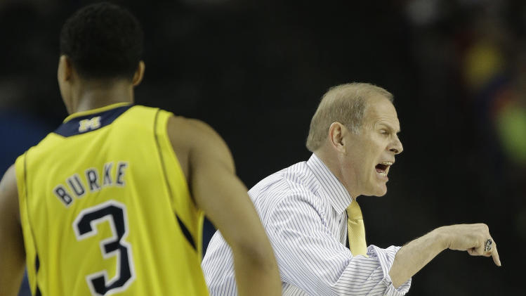 Michigan head coach John Beilein speaks to players during the first half of the NCAA Final Four tournament college basketball championship game against Louisville, Monday, April 8, 2013, in Atlanta. (AP Photo/David J. Phillip)