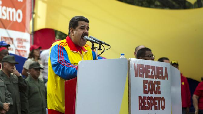 Venezuela's President Maduro speaks from a podium, outside Miraflores Palace in Caracas, Venezuela