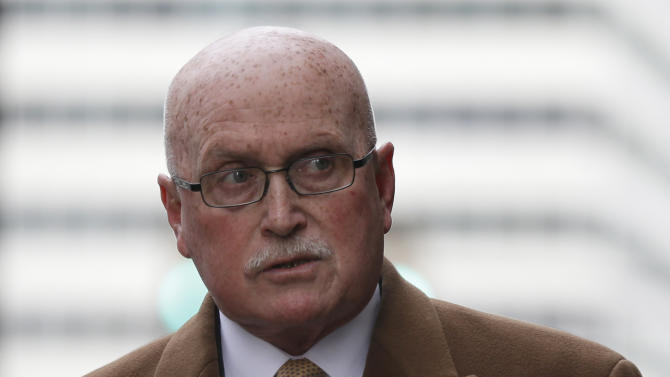 Dr. Kermit Gosnell's defense attorney Jack McMahon walks to the Criminal Justice Center,  Monday, March 18, 2013, in Philadelphia. Gosnell, an abortion doctor who catered to minorities, immigrants and poor women at the Women's Medical Society, goes on trial Monday on eight counts of murder.  (AP Photo/Matt Rourke)