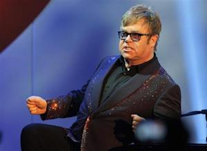 Elton John acknowledges the audience at the 20th Annual Race to Erase MS benefit gala in Los Angeles