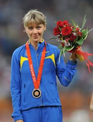 Ukraine&#39;s Nataliya Tobias poses on the podium after taking bronze in the women&#39;s 1500m at the National stadium as part of the 2008 Beijing Olympic Games on August 23, 2008. Kenya&#39;s Nancy Langat took gold with Ukraine&#39;s Iryna Lishchynska in silver and Ukraine&#39;s Nataliya Tobias in bronze.  AFP PHOTO / FABRICE COFFRINI