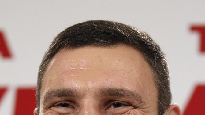 Chairman of the Ukrainian opposition party Udar (Punch) and WBC Heavyweight Champion boxer Vitali Klitschko smiles during his news conference in Kiev, Ukraine, Monday, Oct. 29, 2012. Klitschko's party garnered 13 percent  of the vote during Sunday's parliamentary elections in Ukraine. (AP Photo/Alexander Kosarev)