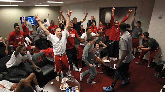 In a photo provided by the University of Alabama, Alabama players celebrate while watching the NCAA men's college basketball tournament selection show Sunday, March 11, 2012, in Tuscaloosa, Ala. Alabama will play Creighton. (AP Photo/University of Alabama, Kent Gidley)