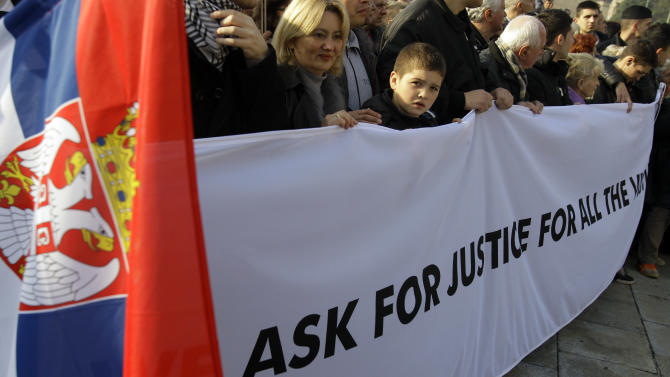"Protesters carrying a banner that reads: ""We ask for justice for all the victims"" during protest march against the Hague  war crimes tribunal, in Belgrade, Serbia, Sunday, Nov. 25, 2012. Serbia is furious that the appeals judges at the war crimes court in the  Hague  last Friday freed  Croat generals Ante Gotovina and Mladen Markac, who previously had been sentenced to lengthy prison terms for crimes against Serbs. (AP Photo/Darko Vojinovic)"