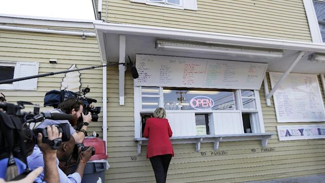 Media documents Democratic presidential candidate Hillary Rodham Clinton ordering ice cream at Dairy Twirl, Friday, July 3, 2015, in Lebanon, N.H. (AP Photo/Elise Amendola)