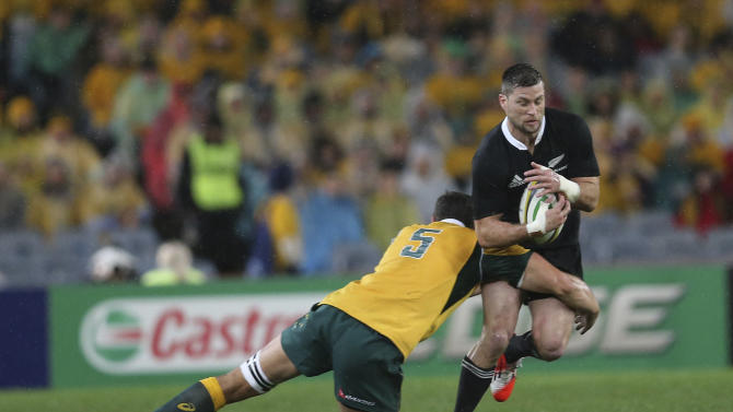 New Zealand All Black Cory Jane is tackled by Australian Wallabies Rob Simmons during their Bledisloe Cup rugby test match in Sydney, Australia, Saturday, Aug. 16, 2014.(AP Photo/Rob Griffith)