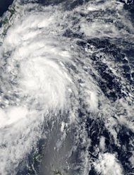 A NASA Aqua satellite image shows Tropical Storm Son-Tinh over the Philippines. In the nation's main southern island of Mindanao more than 15,000 people displaced by the storm are still sheltering at government buildings and receiving disaster aid