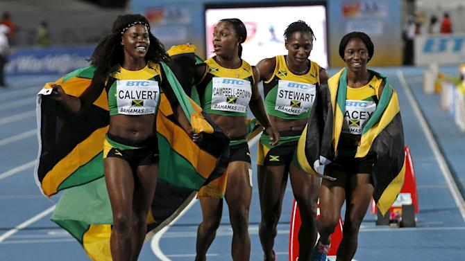 Jamaica's 4x4100 relay team take a victory lap after winning the event at the IAAF World Relays Championships in Nassau