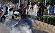 Police And Protesters Clash In Pakistan