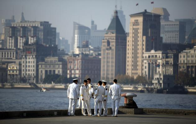 Members of the welcoming ceremony band from the Chinese navy wait for the arrival of the British Royal Navy destroyer HMS Daring to the north side of the bund at Huangpu River in Shanghai