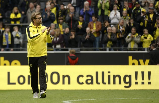 File photo of Borussia Dortmund's coach Klopp applauding after the German first division Bundesliga soccer match against Hoffenheim in Dortmund