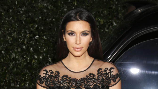 Kim Kardashian attends the Topshop Topman LA Opening Party At Cecconi's in Los Angeles, on Wednesday, Feb. 13, 2013 in Los Angeles. (Photo by Todd Williamson/Invision for/AP)