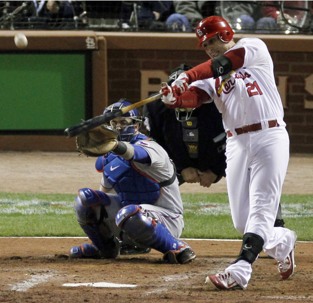 St. Louis Cardinals' Allen Craig hits a solo home run during the third inning of Game 7 of baseball's World Series against the Texas Rangers, Friday, Oct. 28, 2011, in St. Louis. (AP Photo/Jeff Robers