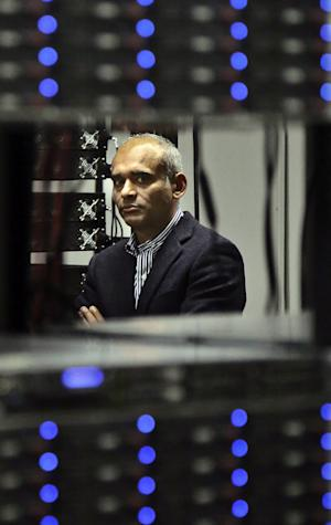 In this Thursday, Dec. 20, 2012, photo, Chet Kanojia, founder and CEO of Aereo, Inc.,  listens during a tour of the company's technology floor in New York.  Aereo is one of several startups created to deliver traditional media over the Internet without licensing agreements. Past efforts have typically been rejected by courts as copyright violations. In Aereo's case, the judge accepted the company's legal reasoning, but with reluctance. (AP Photo/Bebeto Matthews)