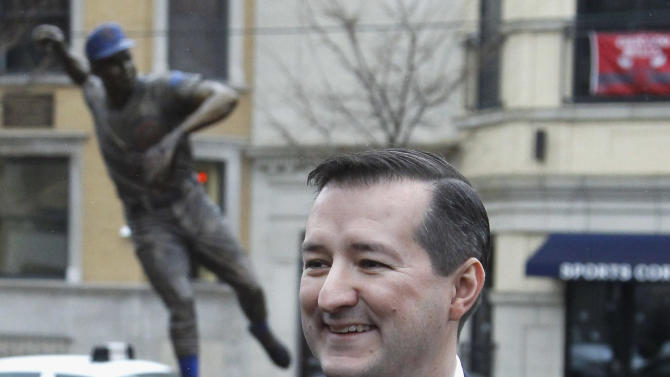 FILE - In this Dec. 5, 2011 file photo, Chicago Cubs owner Tom Ricketts smiles near the statue of Ron Santo outside Wrigley Field in Chicago. Two people with knowledge of the negotiations between the Ricketts family that owns the Cubs and the city say the two are near an agreement on a $500 million project at Wrigley Field. The people spoke Friday, April 5, 2013, on condition of anonymity because the deal was not yet finished and they are not authorized to publicly discuss it. The deal calls for $300 million in renovations at Wrigley and a $200 million hotel nearby. (AP Photo/Charles Rex Arbogast, File)