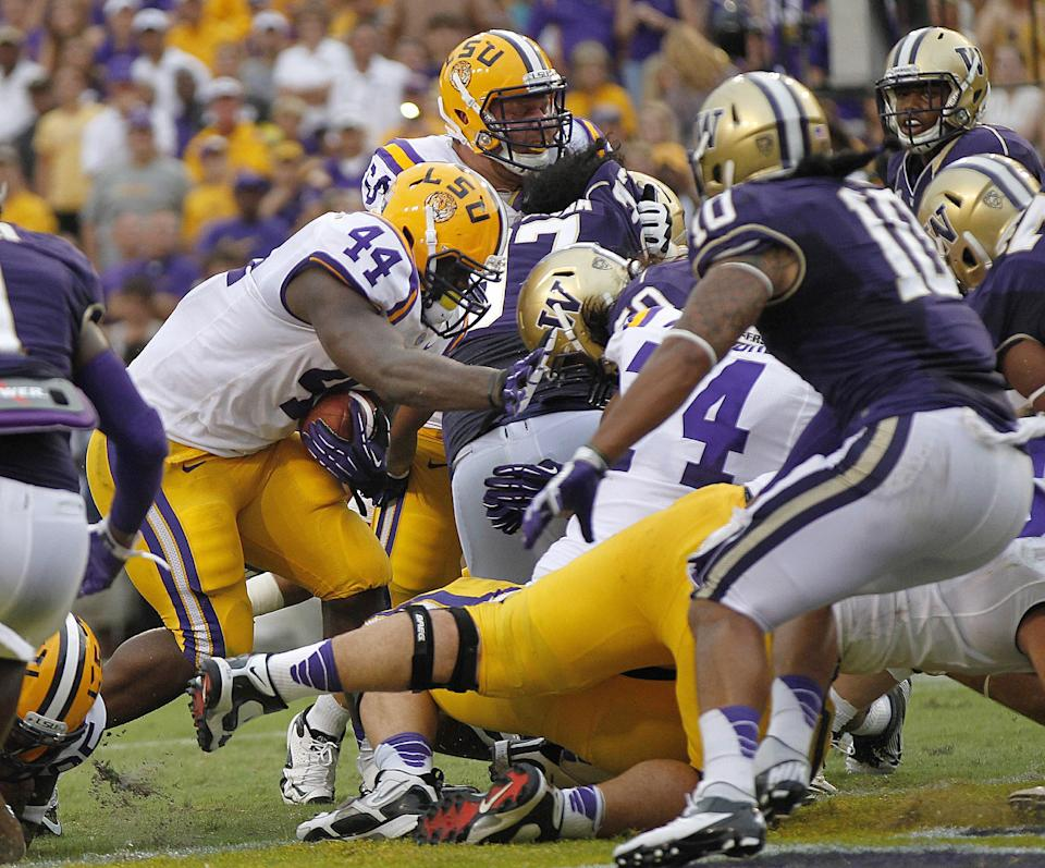 LSU fullback J.C. Copeland (44) scores a touchdown during the first half of an NCAA college football game against Washington in Baton Rouge, La., Saturday, Sept. 8, 2012. (AP Photo/Gerald Herbert)