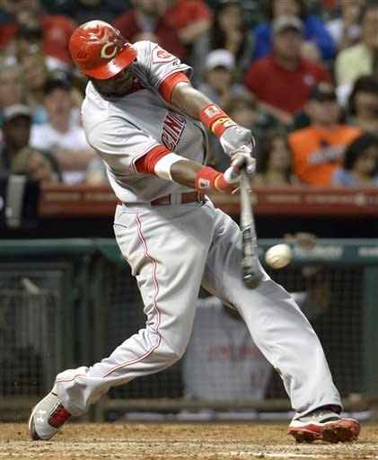 Votto, Reds hand Astros 8th straight loss, 12-9