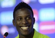 Portuguese forward Silvestre Varela laughs during a press conference at the team's base camp in Opalenica, near Poznan. Varela, scorer of the winning goal in his country's thrilling 3-2 win over Denmark on Friday warned final Euro 2012 Group B opponents Holland were dangerous as they are 'wounded' after two losses