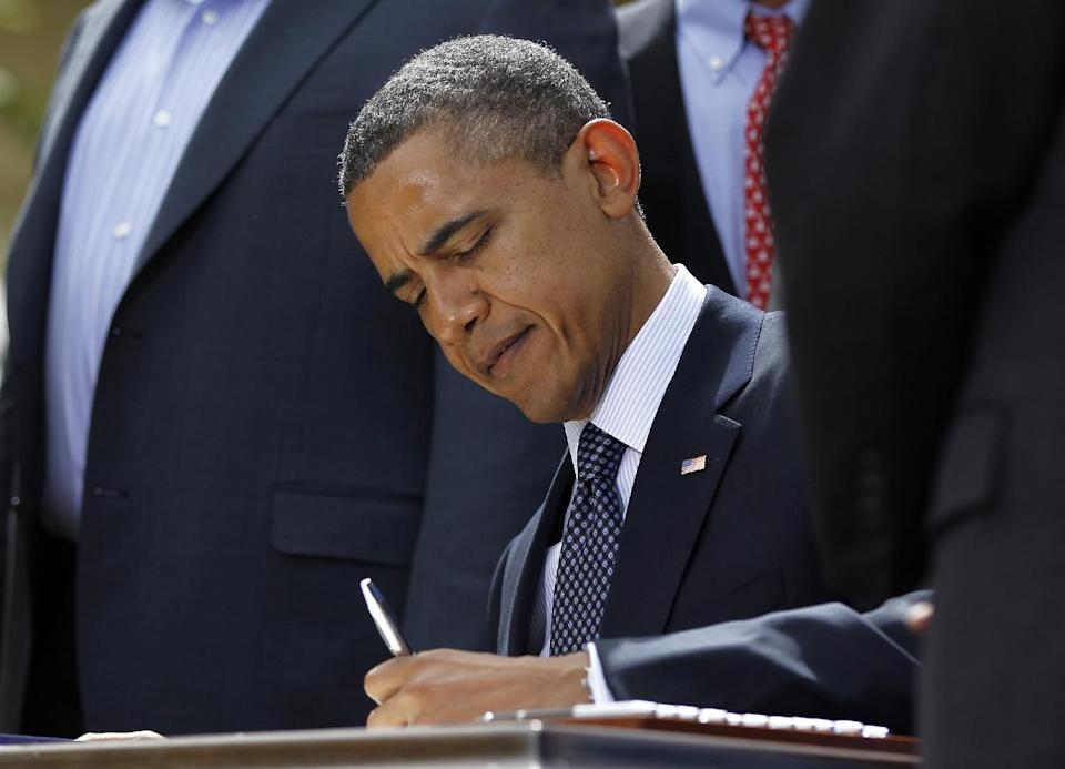 President Barack Obama signs the Jumpstart Our Business Startups (JOBS) Act, Thursday, April 5, 2012, in the Rose Garden of the White House in Washington. (AP Photo/Pablo Martinez Monsivais)