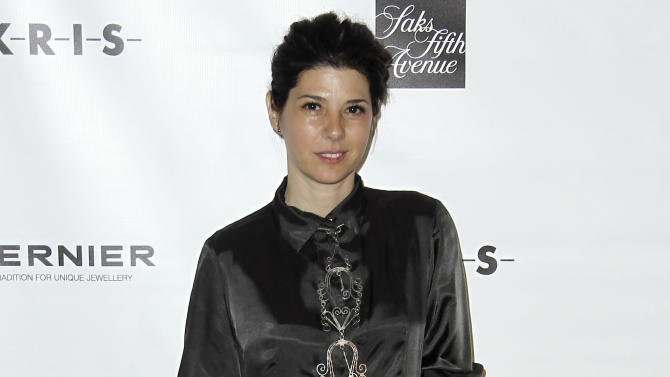 Actress Marisa Tomei arrives at the 7th Annual MOCA Award to Distinguished Women in the Arts luncheon in Beverly Hills, Calif. Tuesday, May 1, 2012.  The event honored photographer Annie Leibovitz.  (AP Photo/Matt Sayles)