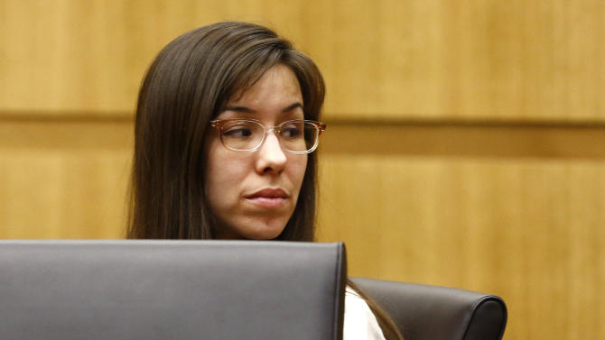 Jodi Arias looks at her family on Monday, May 20, 2013 during the penalty phase of her murder trial at Maricopa County Superior Court in Phoenix, Ariz. Arias was convicted of first-degree murder in the stabbing and shooting to death of Travis Alexander, 30, in his suburban Phoenix home in June 2008. (The Arizona Republic, Rob Schumacher, Pool)