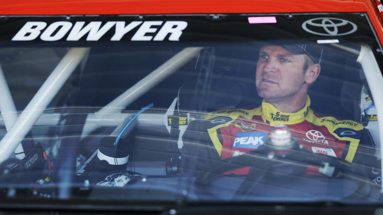 Driver Clint Bowyer waits for the start of practice for Sunday's NASCAR Sprint Cup series auto race at Kansas Speedway in Kansas City, Kan., Friday, April 19, 2013. (AP Photo/Orlin Wagner)