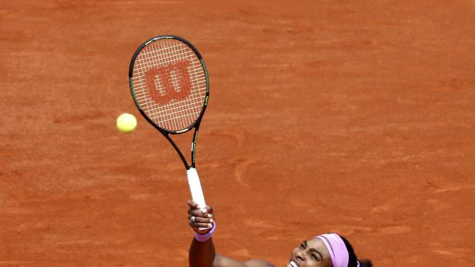 Serena Williams of the U.S. plays a shot to Anna-Lena Friedsam of Germany during their women's singles match at the French Open tennis tournament at the Roland Garros stadium in Paris