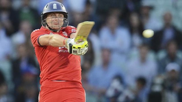 England's Luke Wright hits out during the first T20 international cricket match against New Zealand at the Oval cricket ground, London June 25, 2013. REUTERS