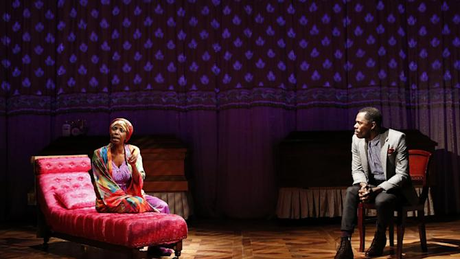 "This theater image released by The Public Theater shows Sharon Washington, left, and Colman Domingo in a scene from Domingo's new play ""Wild With Happy,"" performing off-Broadway at The Public Theater in New York.  (AP Photo/Public Theater, Joan Marcus)"