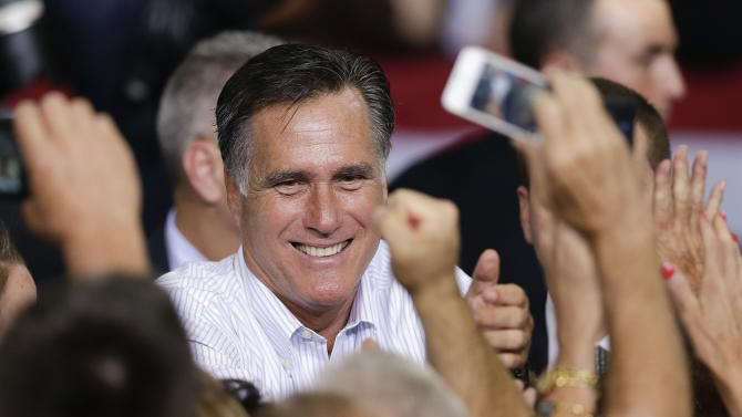 Republican presidential candidate, former Massachusetts Gov. Mitt Romney greets supporters after speaking at a rally Friday, Sept. 21, 2012, in Las Vegas. Romney campaigned in Nevada as aides released a 2011 federal income tax return showing he and his wife, Ann, paid $1.94 million in federal taxes last year on income of $13.7 million. (AP Photo/Julie Jacobson)