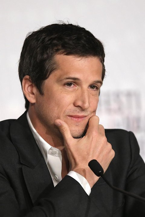 Director Guillaume Canet listens to questions during the press conference of Blood Ties at the 66th international film festival, in Cannes, southern France, Monday, May 20, 2013. (AP Photo/Francois Mo