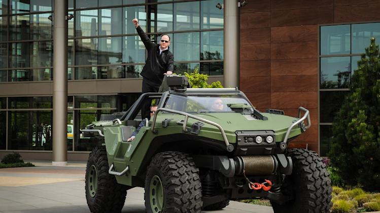 IMAGE DISTRIBUTED FOR PIZZA HUT - Pizza Hut Chief Marketing Officer Kurt Kane arrives aboard the UNSC Warthog from Halo to announce the new Pizza Hut for Xbox LIVE ordering app at the Microsoft campus, Tuesday, April 23, 2013 in Redmond, WA. (Rod Mar/ AP Images for Pizza Hut)