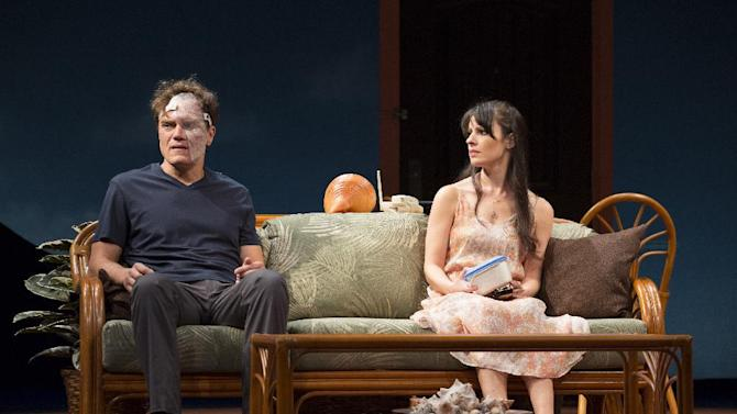 """This theater image released by The O + M Company shows Michael Shannon, left, and Kate Arrington during a performance of """"Grace,""""  at the Cort Theatre in New York. (AP Photo/The O + M Company, Joan Marcus)"""
