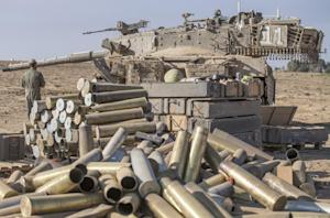 Israeli shell cases are stacked up at an army deployment …