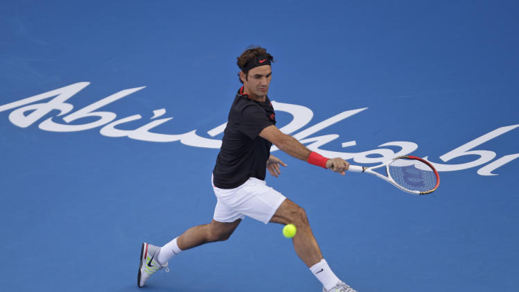 Roger Federer from Switzerland returns the ball to Serbia's Novak Djokovic during the second day of Abu Dhabi Mubadala Tennis Championship, Friday, Dec. 30, 2011 in Abu Dhabi, United Arab Emirates. (AP Photo/Kamran Jebreili)