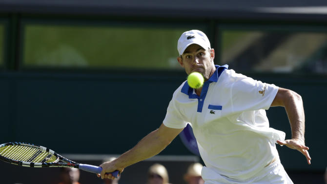 Andy Roddick of the United States plays a return to David Ferrer of Spain during a third round men's singles match at the All England Lawn Tennis Championships at Wimbledon, England, Saturday, June 30, 2012. (AP Photo/Anja Niedringhaus)