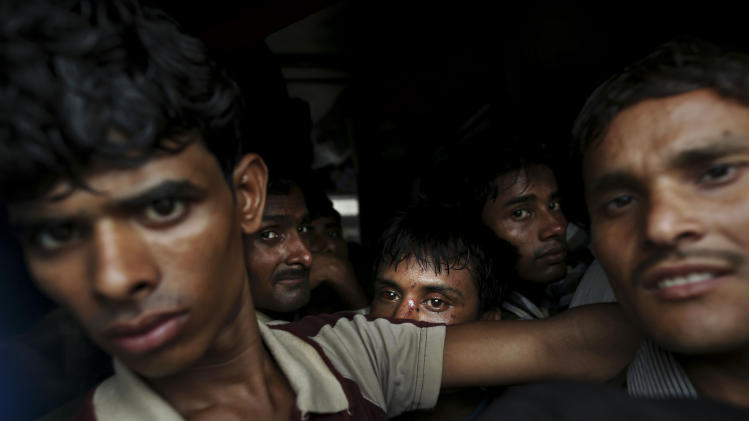 Indian people crowd a door of a train as they wait for the train services to resume following a power outage at a railway station in New Delhi, India, Tuesday, July 31, 2012. India's energy crisis cascaded over half the country Tuesday when three of its regional grids collapsed, leaving 620 million people without government-supplied electricity for several hours in, by far, the world's biggest blackout. Hundreds of trains stalled across the country and traffic lights went out, causing widespread traffic jams in New Delhi. (AP Photo/Kevin Frayer)