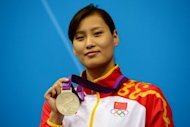 China's Lu Ying poses with her 100m butterfly silver medal at the London 2012 Olympics on July 29. Lu has criticised China's restrictive training methods compared to the freedom of working out in Australia, giving a rare insight into the closed world of Chinese swimming