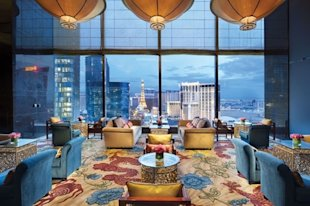 The strip twinkles just beyond the lobby windows of the Mandarin Oriental, Las Vegas.