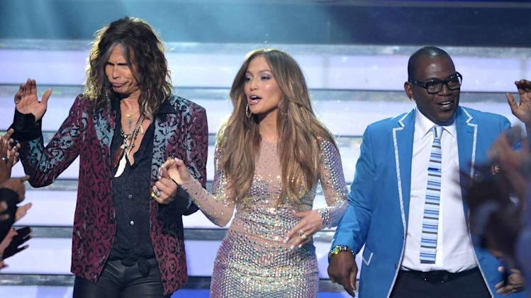 """From left, judges Steven Tyler, Jennifer Lopez and Randy Jackson appear onstage at the """"American Idol"""" finale on Wednesday, May 23, 2012 in Los Angeles. (Photo by John Shearer/Invision/AP)"""