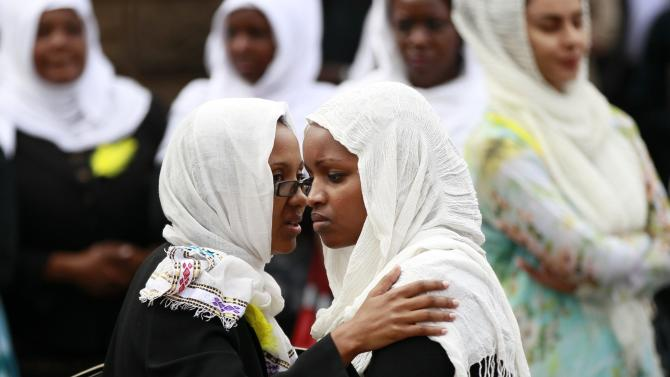 Kenyan journalists gather for the funeral prayers of their colleague Sood, who was killed in the Westgate shopping mall attack, in Nairobi