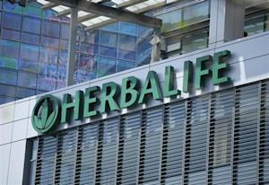 The Herbalife logo is seen on a building housing some of their offices in downtown Los Angeles, California
