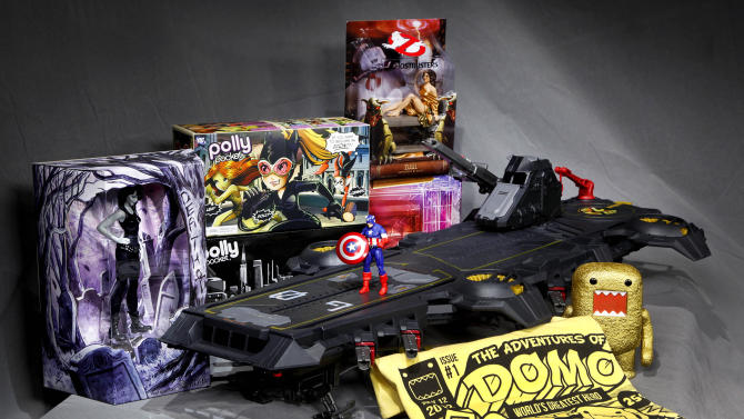 "In this July 5, 2012 photo, the Marvel Universe S.H.I.E.L.D. Super Helicarrier, at center with a Captain America figure on the foredeck, is seen with, from left background, a DC Comics Vertigo Death figurine, the Polly Pocket DC Comics Villain set, and a Dana as Zuul ""Ghostbusters"" figure, all special-issue Comic-Con 2012 collectibles, shown in Los Angeles. The annual four-day Comic-Con festival runs July 12-15, 2012, in San Diego. (AP Photo/Reed Saxon)"