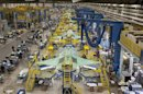 Handout photo of workers on the moving line and forward fuselage assembly areas for the F-35 JSF at Lockheed Martin Corp&#039;s factory located in Fort Worth, Texas