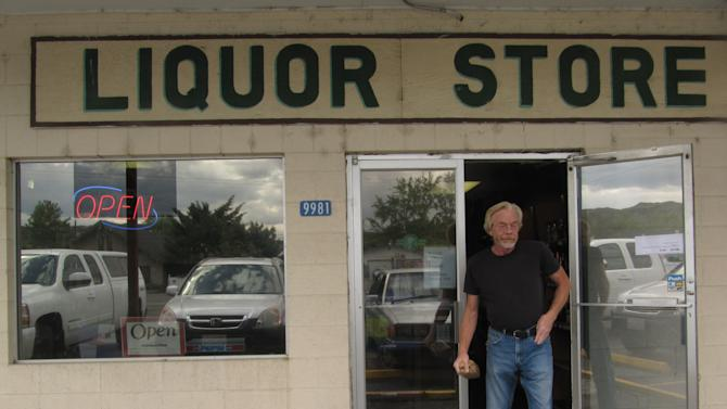 Joe Oldenkamp walks out of the liquor store in Naches, Wash., Friday, May 18, 2012. Many customers at the store have been stocking up in advance of June 1 liquor privatization in Washington state in case prices increase. (AP Photo/Shannon Dininny)