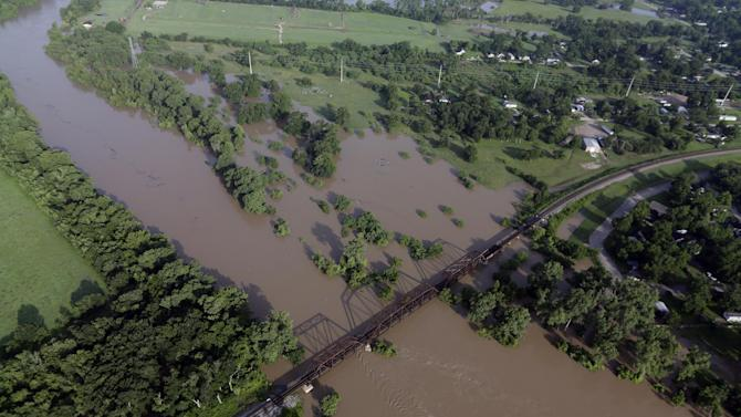 The Colorado Rivers flows out of its banks Saturday, May 30, 2015, in Wharton, Texas. The Colorado River in Wharton and the Brazos and San Jacinto rivers near Houston are the main focus of concern as floodwaters moved from North and Central Texas downstream toward the Gulf of Mexico. (AP Photo/David J. Phillip)